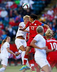 12.06.2015, Commonwealth Stadium, Edmonton, CAN, FIFA WM, Frauen, Kanada vs Neuseeland, Gruppe A, im Bild Canada's Christine Sinclair (Top R) vies with New Zealand's Abby Erceg. The match ended with a 0-0 draw // during group A match of FIFA Women's World Cup between Canada and New Zealand at the Commonwealth Stadium in Edmonton, Canada on 2015/06/12. EXPA Pictures © 2015, PhotoCredit: EXPA/ Photoshot/ Ding Xu<br /> <br /> *****ATTENTION - for AUT, SLO, CRO, SRB, BIH, MAZ only*****