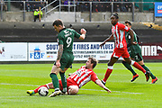 Mark Hughes (3) of Accrington Stanley makes a tackle on Jimmy Spencer (9) of Plymouth Argyle as he is about to shoot at goal during the EFL Sky Bet League 2 match between Plymouth Argyle and Accrington Stanley at Home Park, Plymouth, England on 1 April 2017. Photo by Graham Hunt.