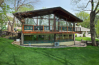Mid-century modern William Dale house in Minneapolis, Minnesota. Frank LLoyd Wright inspired mid-century home in Dellwood, Minnesota. Designed by local architect David Griswold, the prairie school home has strong geometric lines, an open floor plan and natural elements such as interior brick walls and fir clad ceilings.