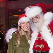 NLD/Hilversum /20131210 - Sky Radio Christmas Tree For Charity 2013, Lucille Werner met de kerstman