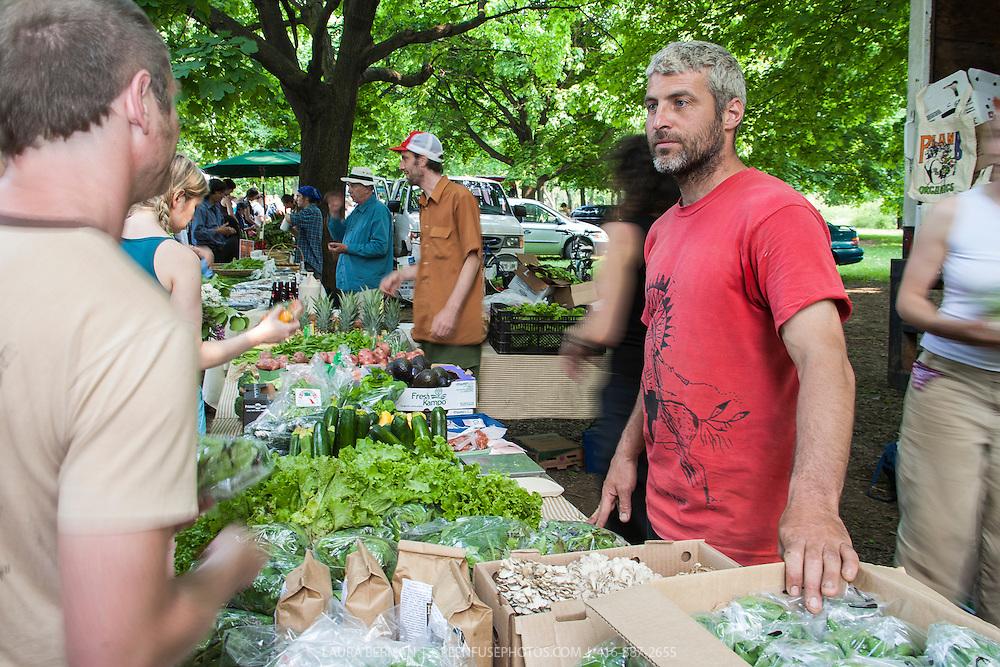 Rod Venturelli at Plan B Organic Farms market table at Dufferin Grove Farmers Market