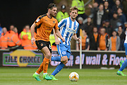 Wolverhampton Wanderers midfielder Ben Marshall (64) on the ball 0-0 during the EFL Sky Bet Championship match between Wolverhampton Wanderers and Brighton and Hove Albion at Molineux, Wolverhampton, England on 14 April 2017. Photo by Alan Franklin.