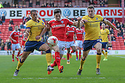 George Williams (Barnsley) and Murray Wallace (Scunthorpe United) go for the ball during the Sky Bet League 1 match between Barnsley and Scunthorpe United at Oakwell, Barnsley, England on 25 March 2016. Photo by Mark P Doherty.