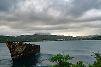 Barge with El Yunque Mountain in the background, Baracoa, Cuba 2020 from Santiago to Havana, and in between.  Santiago, Baracoa, Guantanamo, Holguin, Las Tunas, Camaguey, Santi Spiritus, Trinidad, Santa Clara, Cienfuegos, Matanzas, Havana