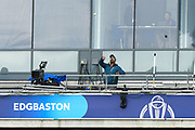 A tv cameraman throws the ball back from the third tier of the pavilion after a six by Rishabh Pant of India during the ICC Cricket World Cup 2019 match between Bangladesh and India at Edgbaston, Birmingham, United Kingdom on 2 July 2019.