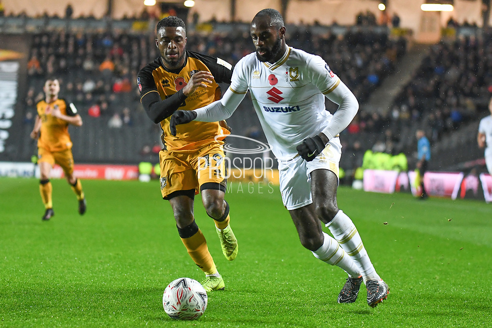 Milton Keynes Dons midfielder Hiram Boateng (26) battles for possession  with Port Vale midfielder David Amoo (19) during the The FA Cup match between Milton Keynes Dons and Port Vale at stadium:mk, Milton Keynes, England on 9 November 2019.