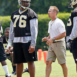 June 6, 2012; Metairie, LA, USA; New Orleans Saints defensive coordinator Steve Spagnuolo works with rookie defensive tackle Akiem Hicks (76) during a minicamp session at the team's practice facility. Mandatory Credit: Derick E. Hingle-US PRESSWIRE