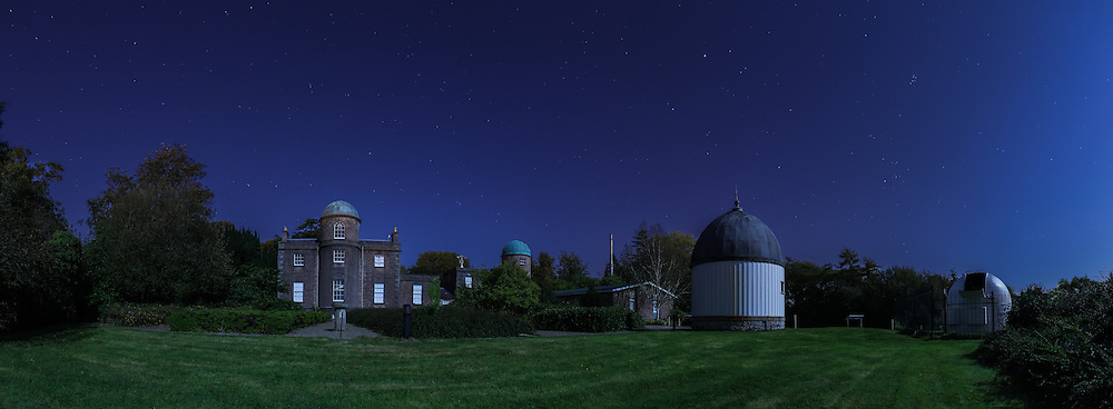 Armagh Observatory by moonlight, with Ursa Major (The Big Dipper) visible just above the Observatory and Capella and The Pleiades off to the right.<br />