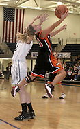 Beavercreek's Amy Green goes airborne as the Beavercreek Lady Beavers take on Kettering's Fairmont High School Lady Firebirds Wednesday night, January 31, 2007.