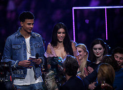 Dele Alli with Camila Cabello on stage during the MTV Europe Music Awards 2017 held at The SSE Arena, London. Photo credit should read: Doug Peters/EMPICS Entertainment