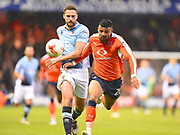 Luton Town player Issac Vassell chases a long pass in the first half  during the EFL Sky Bet League 2 play off second leg match between Luton Town and Blackpool at Kenilworth Road, Luton, England on 18 May 2017. Photo by Ian  Muir.