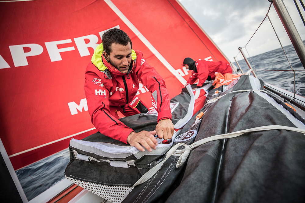 Leg 6 to Auckland, day 04 on board MAPFRE, Blair tuke packing a sail with Sophie Ciszek. 10 February, 2018.