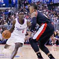 12 February 2014: Portland Trail Blazers point guard Damian Lillard (0) defends on Los Angeles Clippers point guard Darren Collison (2) during the Los Angeles Clippers 122-117 victory over the Portland Trail Blazers at the Staples Center, Los Angeles, California, USA.