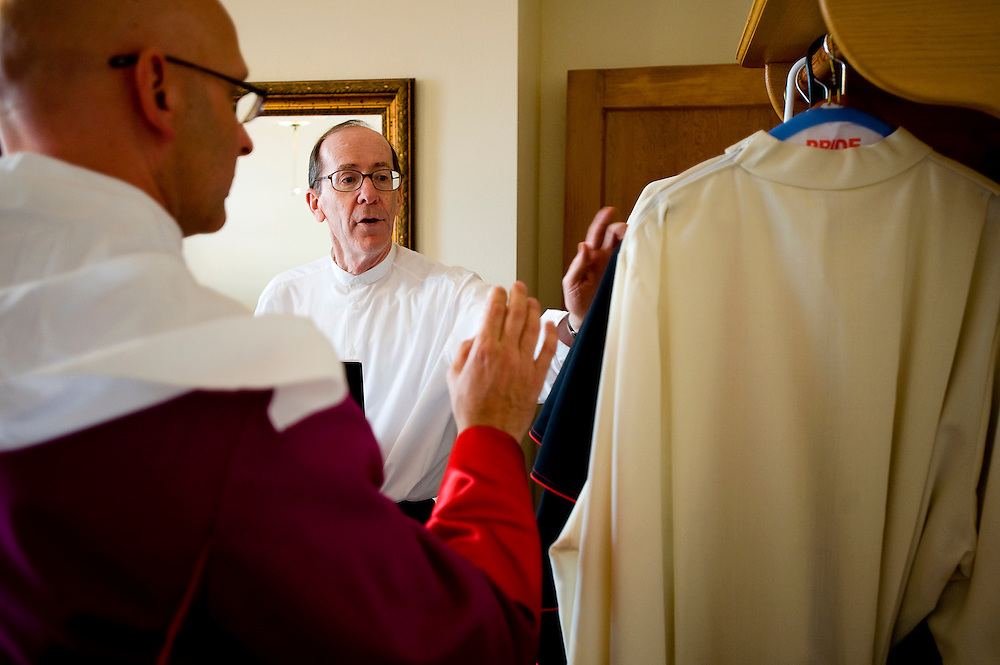 042309     Brian Leddy.Bishop of Phoenix Thomas Olmsted helps Bishop James Wall prepare for vesting before Thursday's ordination ceremony at Sacred Heart Cathedral. Wall was appointed by Pope Benedict XVI to head the diocese.