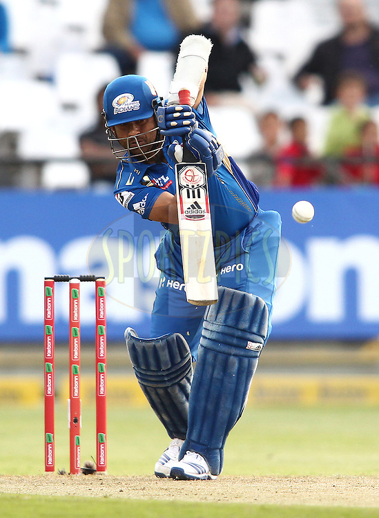 Sachin Tendulkar of the Mumbai Indians straight drives a delivery during match 11 of the Karbonn Smart CLT20 South Africa between The Mumbai Indians and Yorkshire held at Newlands Stadium in Cape Town, South Africa on the 18th October 2012..Photo by Shaun Roy/SPORTZPICS/CLT20
