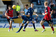 8th September 2019; Dens Park, Dundee, Scotland; Tunnocks Caramel Wafer Cup, Dundee Football Club versus Elgin City; Shaun Byrne of Dundee clears from Rabin Omar and Russell Dingwall of Elgin City