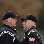 Umpires discuss a call during the High School Baseball ball game between St. Joseph (Trumbull, CT) and McMahon Senators at Brien McMahon High School. Norwalk, Connecticut. USA. 14th May 2013. Photo Tim Clayton