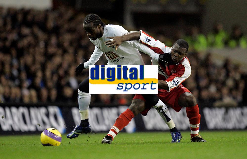 Photo: Marc Atkins.<br /> Tottenham Hotspur v Middlesbrough. The Barclays Premiership. 05/12/2006. Pascal Chimbonda (L) od Spurs tangles with Yakubu of Boro.