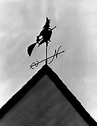 Every Halloween a house decoration that's really with it: a weather vane crowned with a witch and cat flying a broom. The vane on the house in the Magnolia area is a neighborhood conversation piece. A neighbor said it has been on the roof 50 years. (Peter Liddell / The Seattle Times, 1983)