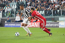 September 27, 2017 - Turin, Piedmont, Italy - Alex Sandro  (Juventus FC) and Felipe Pardo (Olympiacos FC)  compete for the ball during the UEFA Champions League (Group D) football match between Juventus FC and Olympiakos FC  at Allianz Stadium on 27 September, 2017 in Turin, Italy. .Juventus won 2-0 over Olympiakos. (Credit Image: © Massimiliano Ferraro/NurPhoto via ZUMA Press)