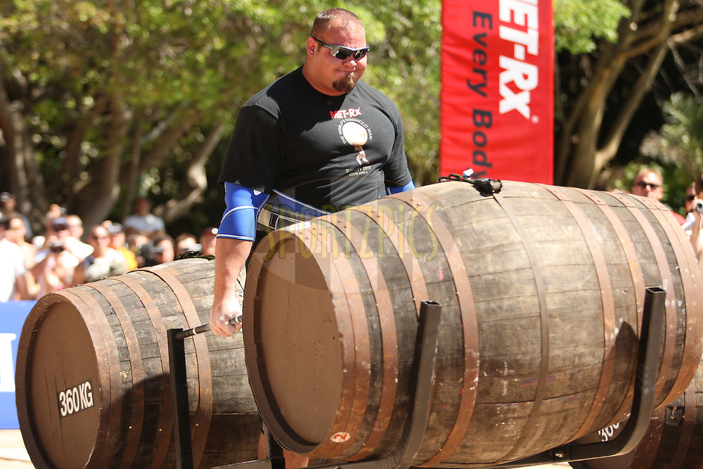 Brian Shaw (USA) makes his way to the finish line in the whiskey-barrel walk during the final rounds of the World's Strongest Man competition held in Sun City, South Africa.