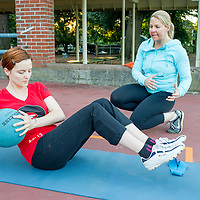 Personal trainer Angelique Tourbier of Studio Blue (right) directs Anna Rigby with her morning workout in Wallace Park (NW 25th Ave. and Raleigh St.) 6:19am