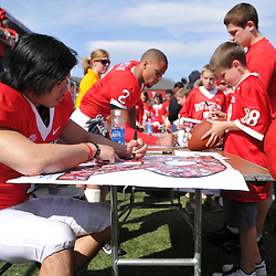 Apr 18, 2009; Piscataway, NJ, USA; Rutgers PK San San Te (1) and WR Tim Brown (2) sign autographs for fans following Rutgers' Scarlet and White spring football scrimmage.