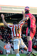 Connor essam heads clear during the The FA Cup match between Cheltenham Town and Dover Athletic at Whaddon Road, Cheltenham, England on 7 December 2014.