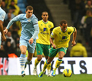 Picture by Paul Chesterton/Focus Images Ltd.  07904 640267.03/12/11.Elliott Bennett of Norwich and Edin Dzeko of Man City in action during the Barclays Premier League match at the Etihad Stadium, Manchester.