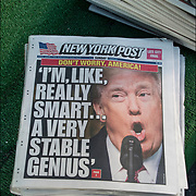 Humorous political newspaper cover headlines about  President Trump newest actions.<br /> <br /> New York Post headlines &quot;Don't Worry, America! I'm, Like, Really Smart...A Very Stable Genius&quot;