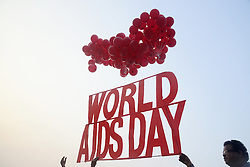 November 30, 2016 - Kolkata, West Bengal, India - Social Activist release HIV/AIDS campaigns material and red ribbon into air during the awarness campaign in Kolkata. Thalasaemia and AIDS Prevention Society member organize a awareness program on eradication of HIV/AIDS and its stigma, panic and discrimination from our society ahead of Worlds AIDS day. World AIDS day is observed annually on December 1 to raise awareness about HIV/AIDS and to demonstrate solidarity in the face of pandemic. (Credit Image: © Saikat Paul/Pacific Press via ZUMA Wire)