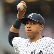 Yangervis Solarte, New York Yankees, fielding during the New York Yankees V Baltimore Orioles home opening day at Yankee Stadium, The Bronx, New York. 7th April 2014. Photo Tim Clayton