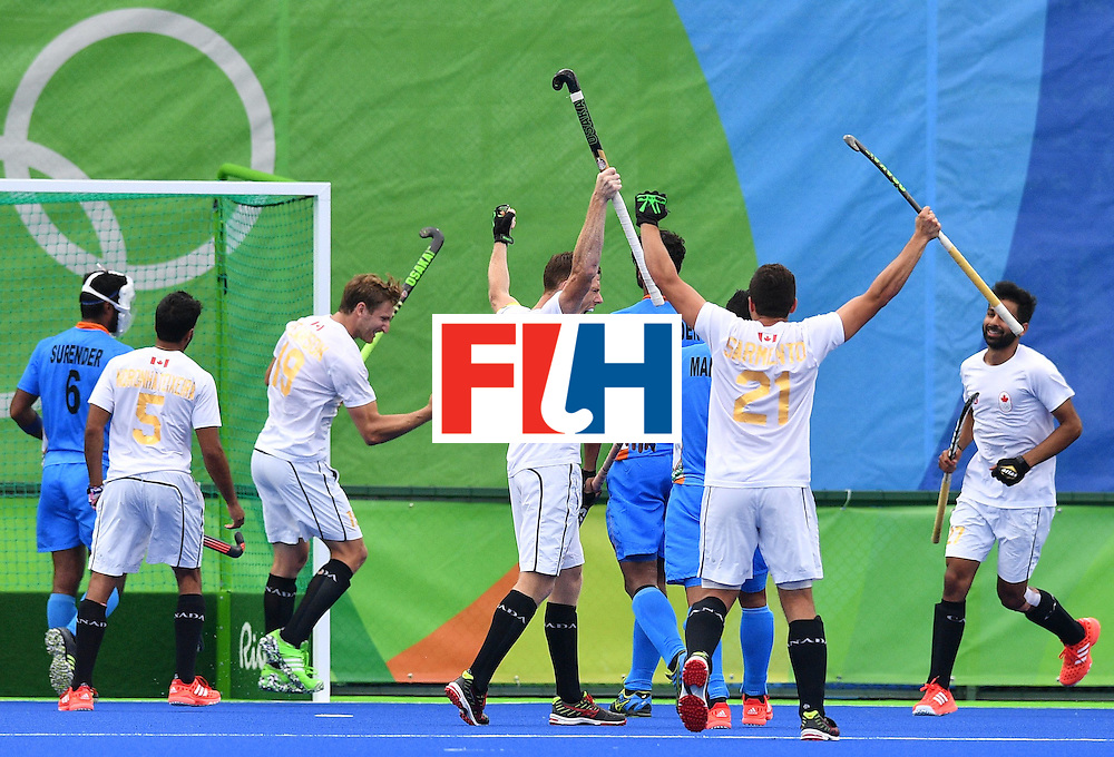 Canada's Scott Tupper celebrates scoring with his teammates during the mens's field hockey India vs Canada match of the Rio 2016 Olympics Games at the Olympic Hockey Centre in Rio de Janeiro on August, 12 2016. / AFP / Carl DE SOUZA        (Photo credit should read CARL DE SOUZA/AFP/Getty Images)