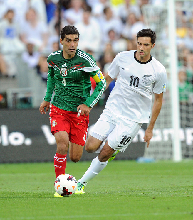 Mexico's Rafael Marquez,left in front of New Zealand's Rory Fallon in the World Cup Football qualifier, Westpac Stadium, Wellington, New Zealand, Wednesday, November 20, 2013. Credit:SNPA / Ross Setford