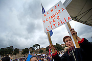 """Rome jan 30th 2016, people gather at Rome's Circus Maximus. Thousands of people were gathering in Rome's Circus Maximus for a pro-family protest that opposes proposed legislation permitting civil unions for same-sex couples and legal recognition for their families. In the picture protester with a banner: """"Renzi (the premier) disaster for Italy"""""""