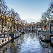 View of one of the Unesco world heritage famous city canals (Brouwersgracht) of Amsterdam, The Netherlands.