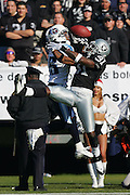 OAKLAND, CA - DECEMBER 19:  Wide receiver Derrick Mason #85 (caught 9 passes for 121 yards and a touchdown) of the Tennessee Titans goes airborne for a pass while defended by cornerback Phillip Buchanon #31 of the Oakland Raiders at Network Associates Coliseum on December 19, 2004 in Oakland, California. The Raiders defeated the Titans 40-35. ©Paul Anthony Spinelli *** Local Caption *** Derrick Mason;Phillip Buchanon