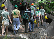 Bear Mountain, New York - Volunteers with hard hats lead the way up a newly rebuilt section of the Appalachian Trail during National Trails Day at Bear Mountain on June 5, 2010. A ceremony and hike celebrated the reconstruction of this original section of the Appalachian Trail. More than 800 volunteers, along with professionals, built 800 hand-hewn rock steps and a broad, gently sloping trail bed atop nearly a mile of rock wall.