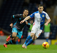 Craig Conway of Blackburn Rovers (right) is closed down by Liam Palmer of Sheffield Wednesday during the Sky Bet Championship match at Ewood Park, Blackburn<br /> Picture by Russell Hart/Focus Images Ltd 07791 688 420<br /> 28/11/2015