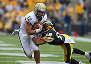 September 17, 2011: Pittsburgh Panthers quarterback Tino Sunseri (12) is hit by Iowa Hawkeyes cornerback Micah Hyde (18) during the second half of the game between the Iowa Hawkeyes and the Pittsburgh Panthers at Kinnick Stadium in Iowa City, Iowa on Saturday, September 17, 2011. Iowa defeated Pittsburgh 31-27.