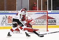 2020-03-07   Ljungby, Sverige: Bodens HF (28) Marcus Sandström precis innan han gör mål (2-3) bakom Troja-Ljungby (36) Wictor Ragnewall under matchen i Hockeyettan mellan IF Troja/Ljungby och Bodens HF i Ljungby Arena ( Foto av: Fredrik Sten   Swe Press Photo )<br /> <br /> Nyckelord: Ljungby, Ishockey, Hockeyettan, Ljungby Arena, IF Troja/Ljungby, Bodens HF, fstb200307, playoff, kval