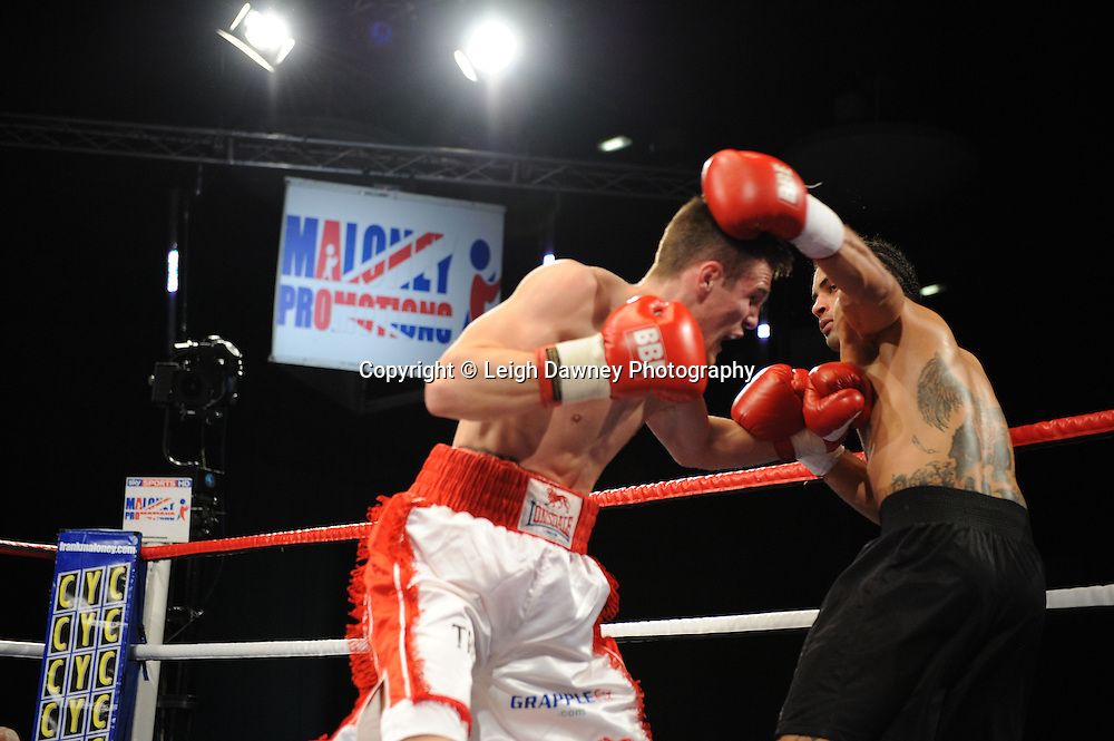 Johnson McLumpha (red/white shorts) defeats Jason Ball in a 4x3 Middleweight contest at the Premier Suite, Reebok Stadium, Bolton, UK on 22.10.11. Frank Maloney Promotions. Photo credit: © Leigh Dawney.