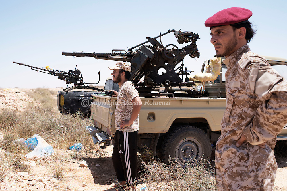 Libya: Libya's Government of National Accord's (GNA) fighters look at ISIS position in Sirte. Alessio Romenzi