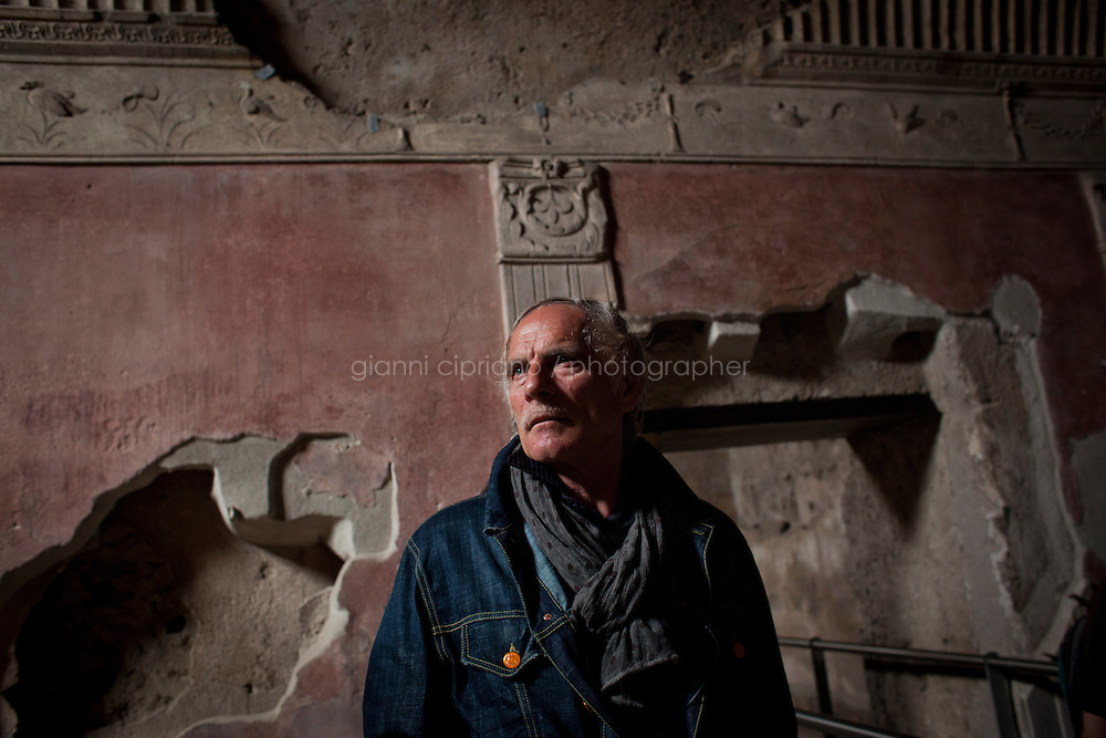 POMPEII, ITALY - 4 APRIL 2013: Mattia Buondonno, 50, guide of the Superintendence of Pompeii, observes one of the rooms of the Stabian Baths, the city's most ancient bath building (2nd century BC),  in Pompeii, Italy, on April 4th, 2013...In recent years, a series of collapses at the site have alarmed conservationists, who warn that the ancient Roman city is dangerously exposed to the elements ? and poorly served by the red tape, lack of strategic planning and limited personnel of the site's historically troubled management. ..Pompeii, along with Herculaneum, was buried under 4 to 6 meters (13 to 20 ft) of ash and pumice in the eruption of Mount Vesuvius in 79 AD. After its initial discovery in 1599, Pompeii was rediscovered as the result of intentional excavations in 1748 by the Spanish military engineer Rocque Joaquin de Alcubierre...Pompeii is an UNESCO World Heritage Site and one of the most popular tourist attractions of Italy, with approximately 2.5 million visitors every year...Gianni Cipriano for The New York Times