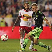Thierry Henry, (left), New York Red Bulls, challenges Andy Rose, Seattle Sounders, during the New York Red Bulls Vs Seattle Sounders, Major League Soccer regular season match at Red Bull Arena, Harrison, New Jersey. USA. 20th September 2014. Photo Tim Clayton