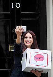 © Licensed to London News Pictures. 08/10/2018. Labour MP LUCIANA BERGER takes a selfie as she and other campaigners hand the Mental Health First Aid England  petition titled 'Where's Your Head At?' at the front door of 10 Downing Street, calling for a law change. Photo credit: Ben Cawthra/LNP