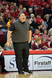 31 December 2008:  Marty Simmons attempts to get the attention of one of his players.  Illinois State University Redbirds extended their record to 13-0 with an 80-50 win over the Evansville Purple Aces on Doug Collins Court inside Redbird Arena on the campus of Illinois State University in Normal Illinois