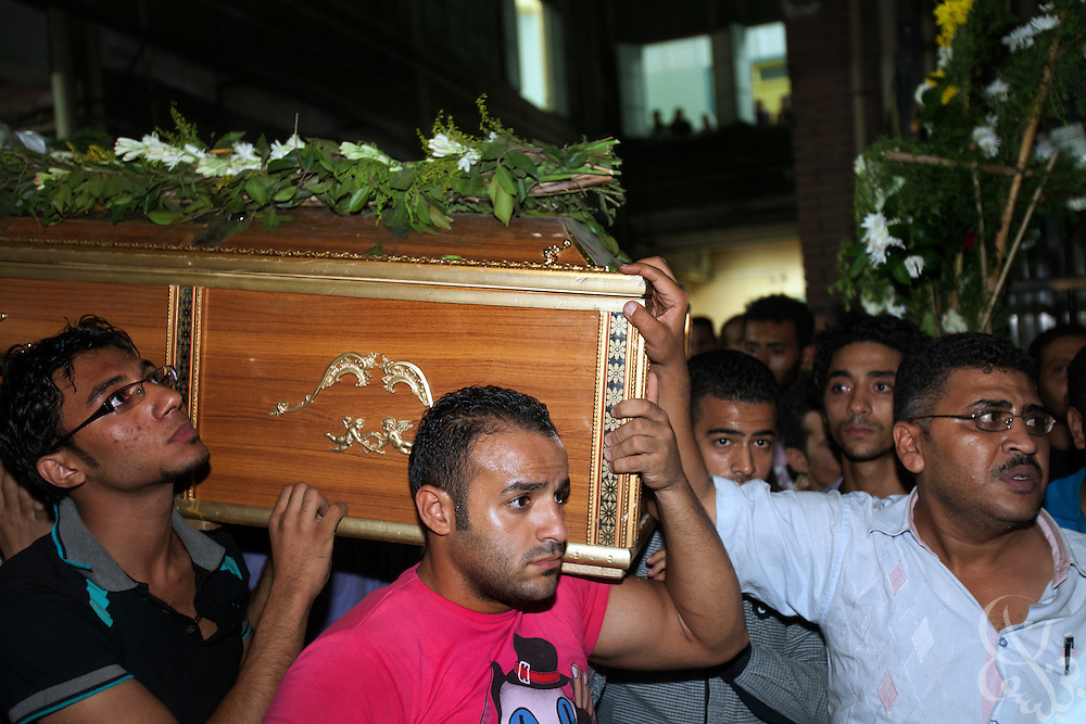 Egyptian Coptic Christians carry the coffin of a victim of sectarian violence October 10, 20011 at the Coptic Hospital in Cairo, Egypt. At least 26 people, mostly Christian, were killed during sectarian clashes that saw the worst violence since the Revolution that toppled former Egyptian president Hosni Mubarak earlier this year. Egyptian Coptic Christians make up about 10% of Egypt's 80 million population and periodically violence flares between the Christian minority and the majority Muslim population. (Photo by Scott Nelson)