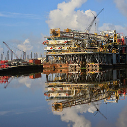 A rig sits dockside at the Port of Iberia, Louisiana, U.S., on Friday, August 19, 2016.  Photographer: Derick E. Hingle/Bloomberg