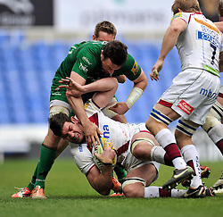 Nathan Hines of Sale Sharks is tackled to ground by Tom Guest of London Irish - Photo mandatory by-line: Patrick Khachfe/JMP - Mobile: 07966 386802 12/04/2015 - SPORT - RUGBY UNION - Reading - Madejski Stadium - London Irish v Sale Sharks - Aviva Premiership